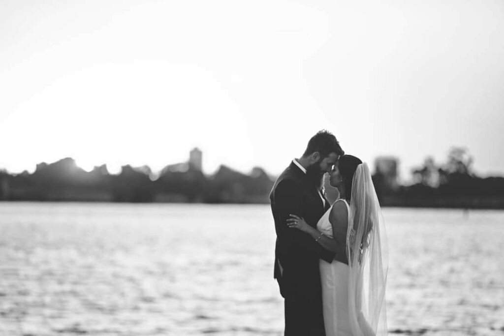 A bride and groom on the banks of the Swan River, Perth Australia